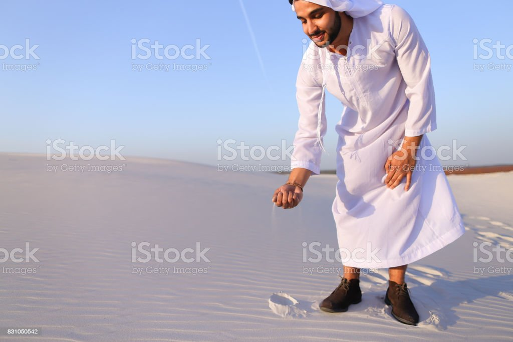 Muslim man develops sand along wind and standing in middle of de stock photo