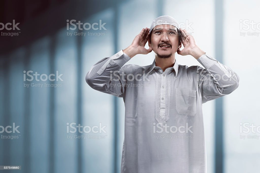 Muslim man doing adzan stock photo