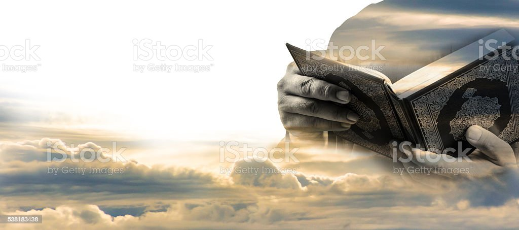 Muslim Man holding the Koran ,Double Exposure Effect stock photo