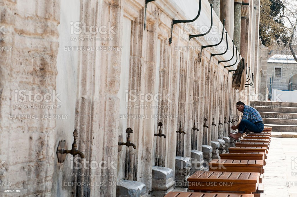 Muslim man perform ablution (wudhu) before pray, Istanbul, Turkey royalty-free stock photo