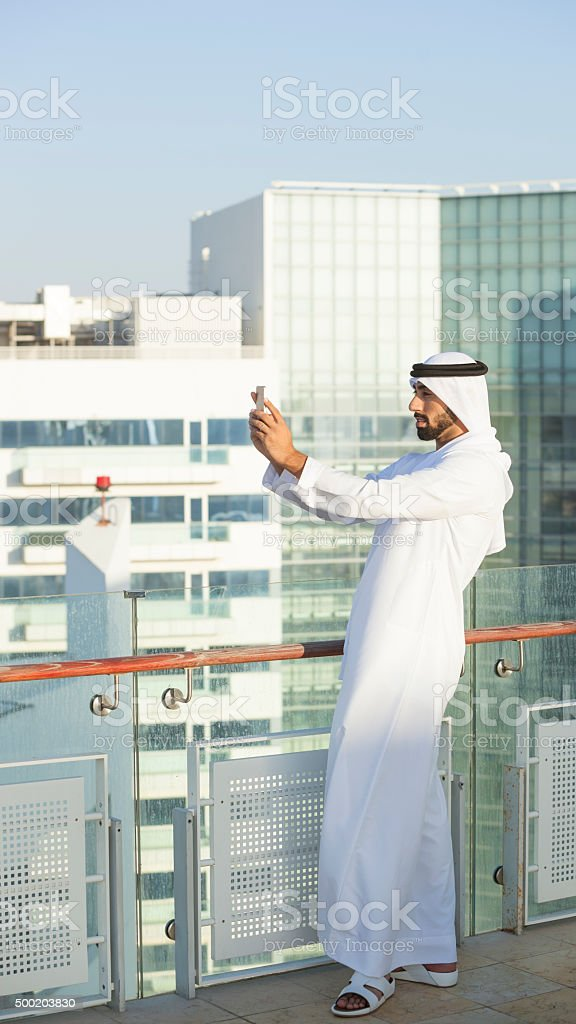 Muslim Man Photographing The Growing City stock photo