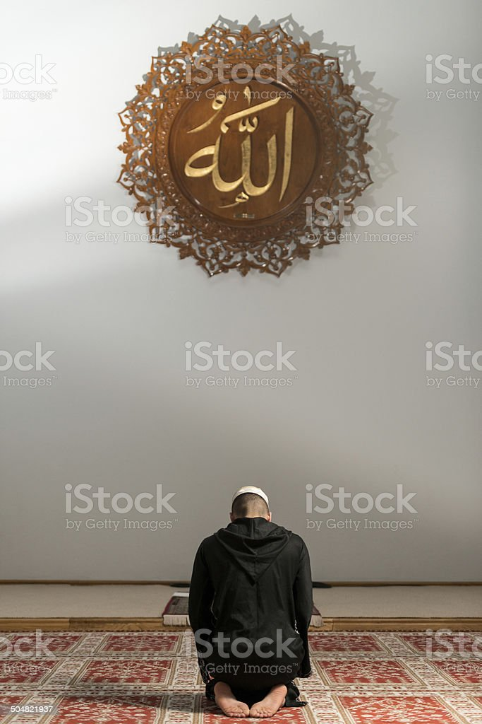 Muslim Man Praying At Mosque stock photo
