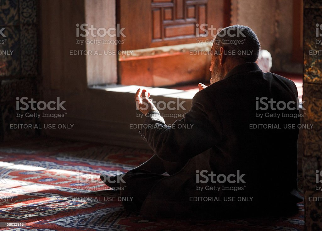 muslim man praying at the Sultan Ahmed Mosque stock photo