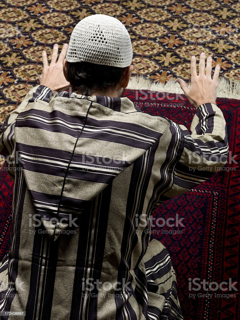 Muslim man praying royalty-free stock photo