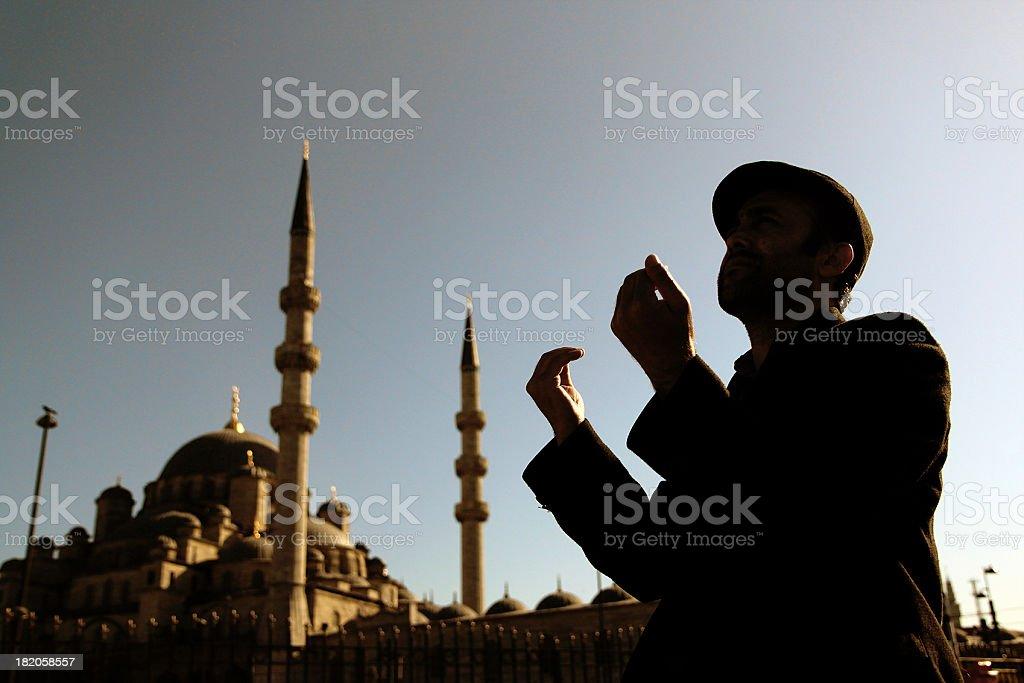 muslim man praying stock photo