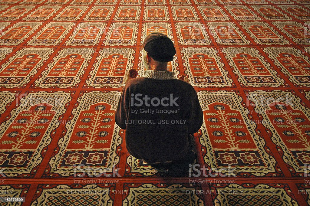 Muslim man praying stock photo