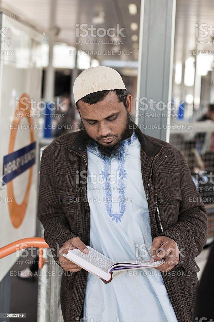 Muslim man Reading the Koran in London royalty-free stock photo