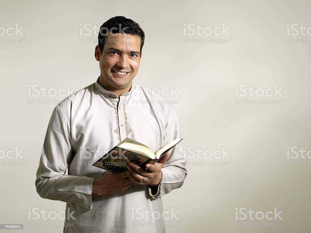 Muslim man reading the koran royalty-free stock photo