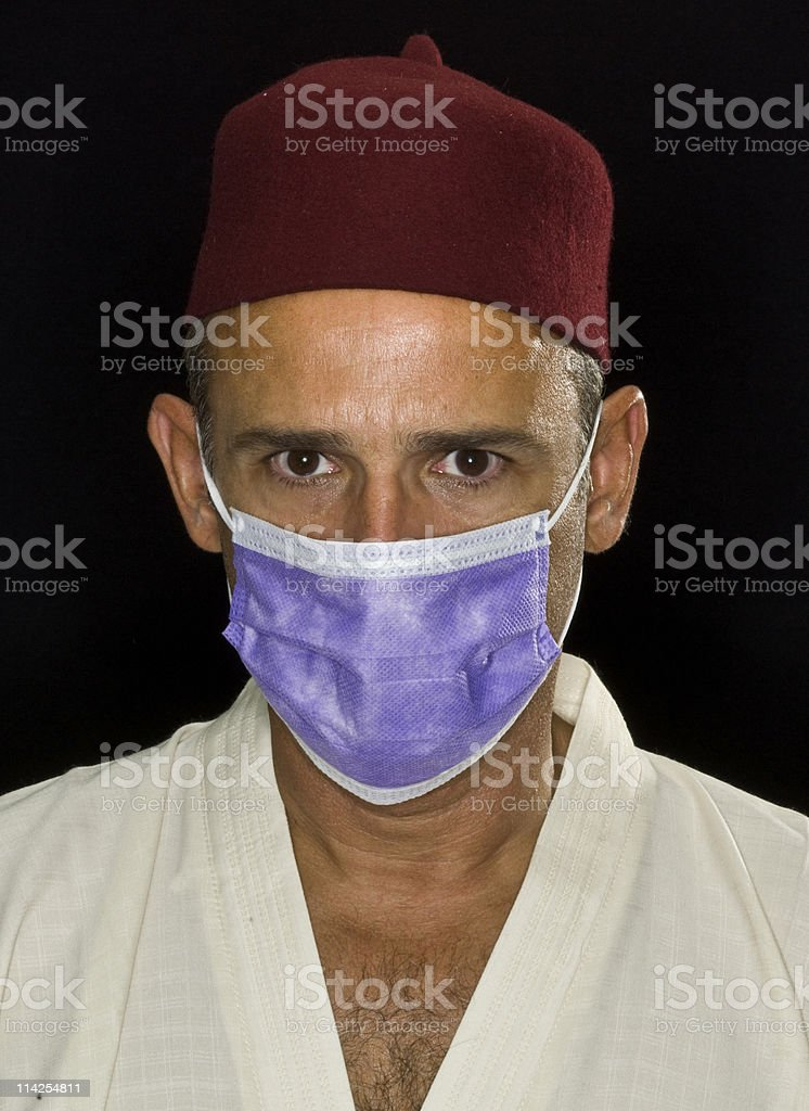 Muslim man wearing a flu mask stock photo