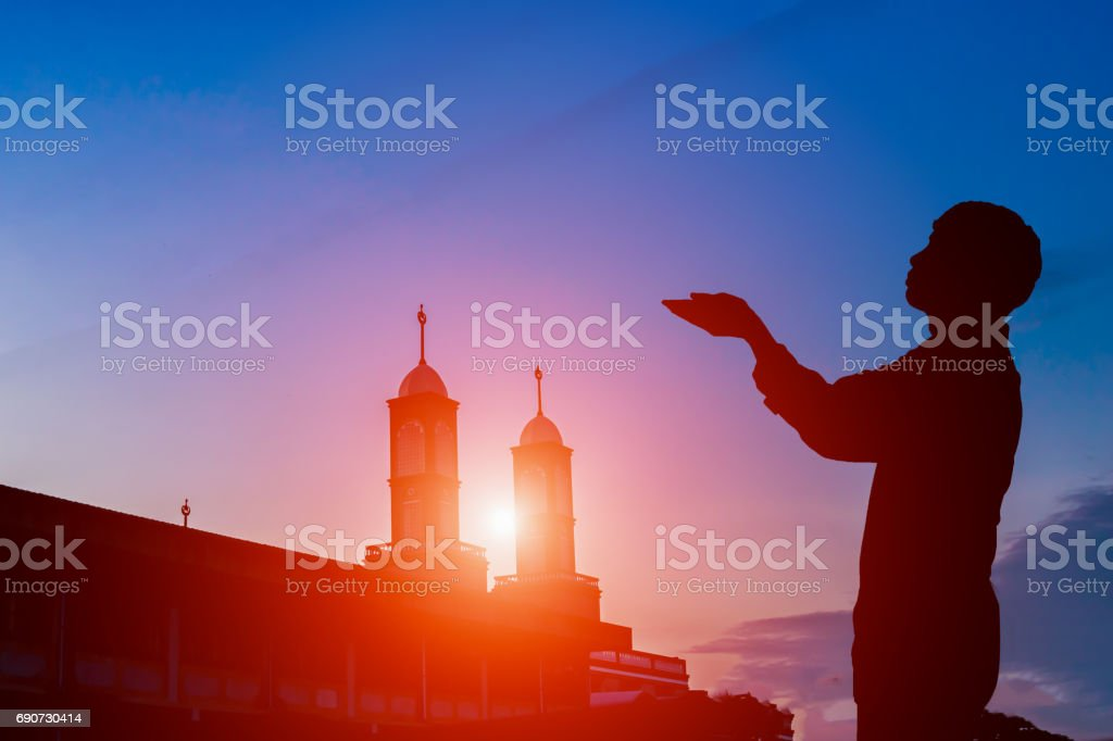 Muslim men pray for a blessing from God. stock photo