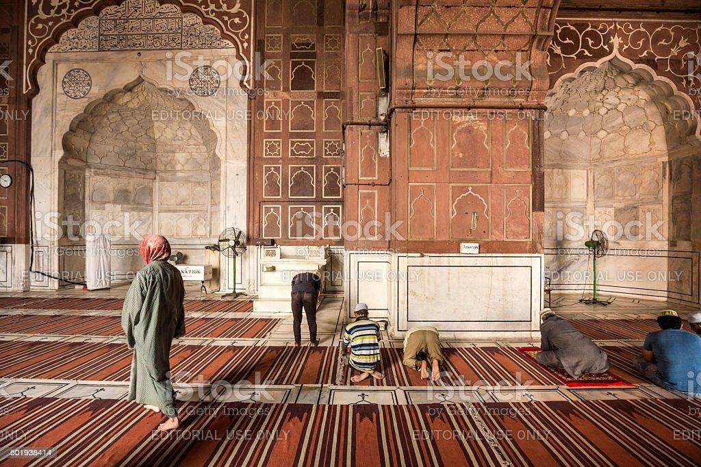 Muslim men praying in Jama Masjid mosque Delhi India stock photo