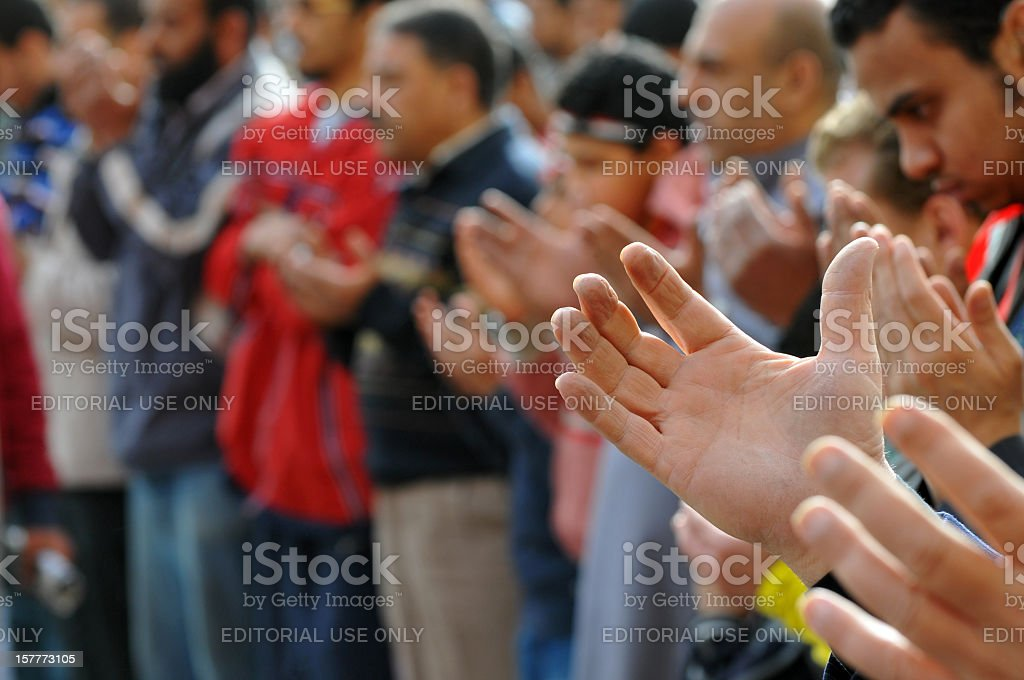 Praying people in Tahrir Square stock photo