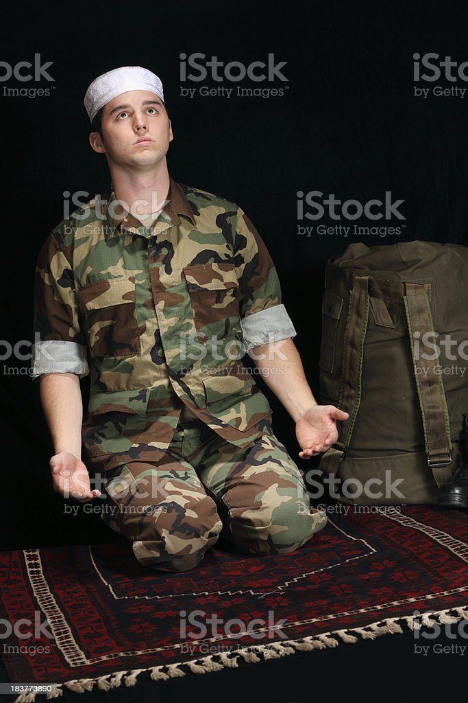 Muslim Military Man Prays to Allah stock photo
