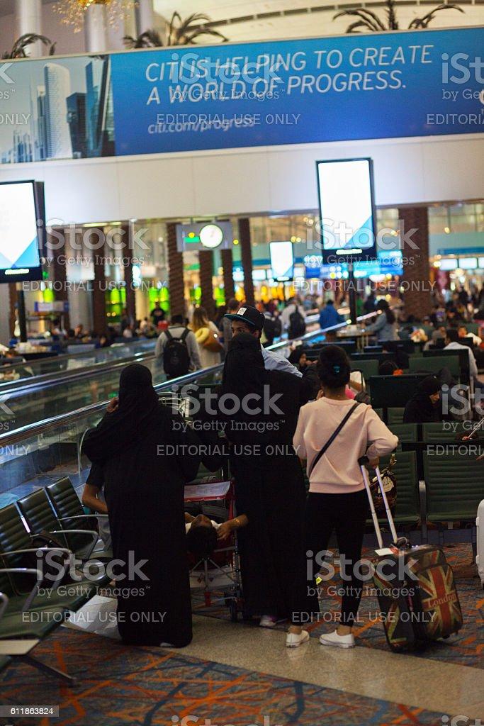 Muslim passengers in transit area stock photo
