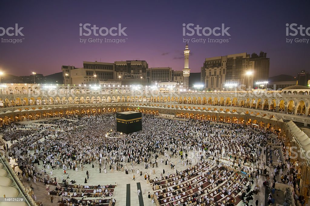 Muslim pilgrims circumambulate the Kaaba at dawn stock photo