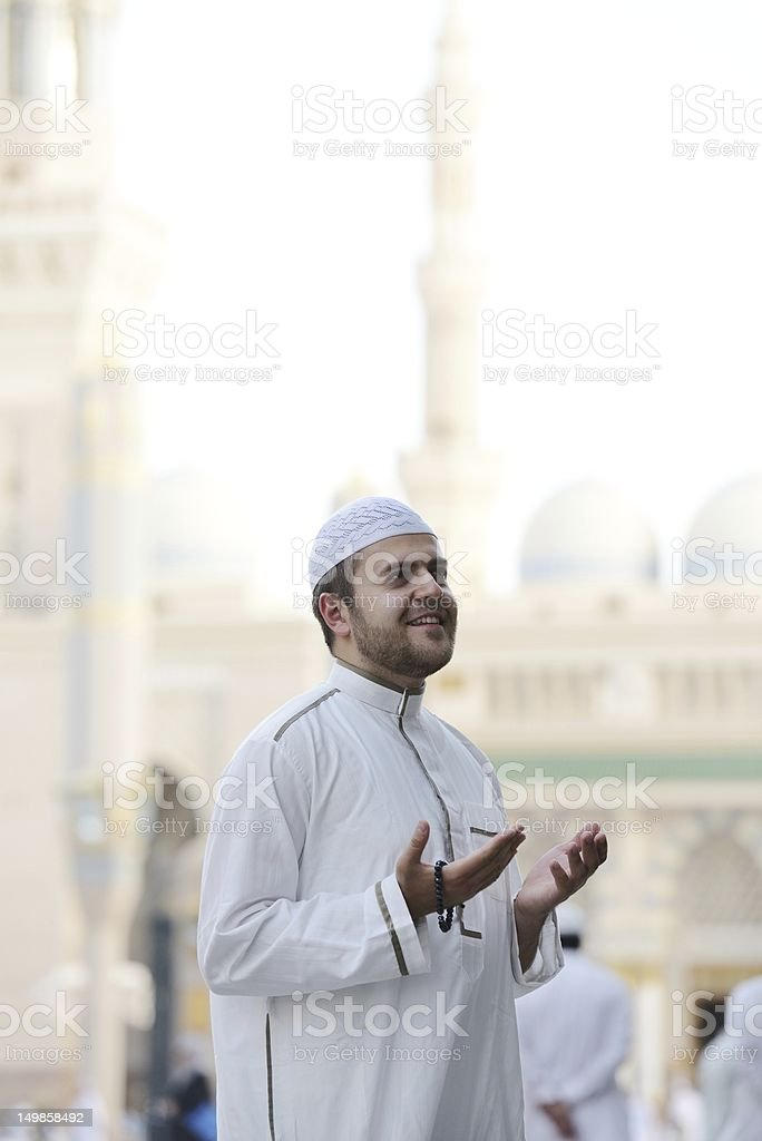 Muslim prayer at holy mosque stock photo