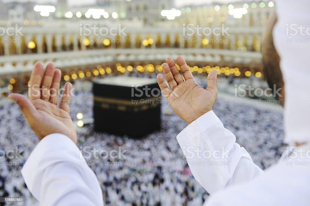 Muslim praying at Mekkah with hands up stock photo