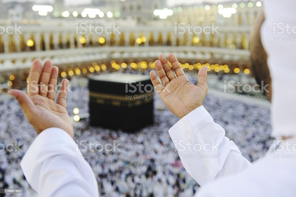 Muslim praying at Mekkah with hands up stock photo