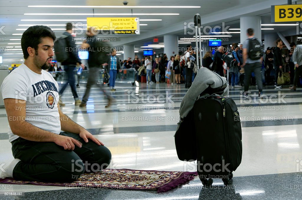 Muslim Praying in Airport stock photo