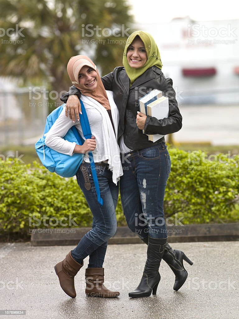 Muslim students teenage girls stock photo