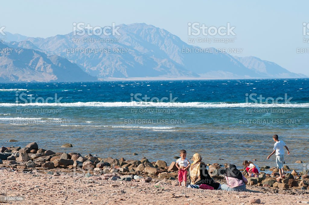Muslim woman and children (Dahab, Egypt) stock photo