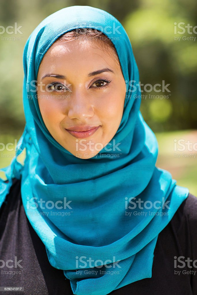 Muslim woman closeup portrait outdoors stock photo