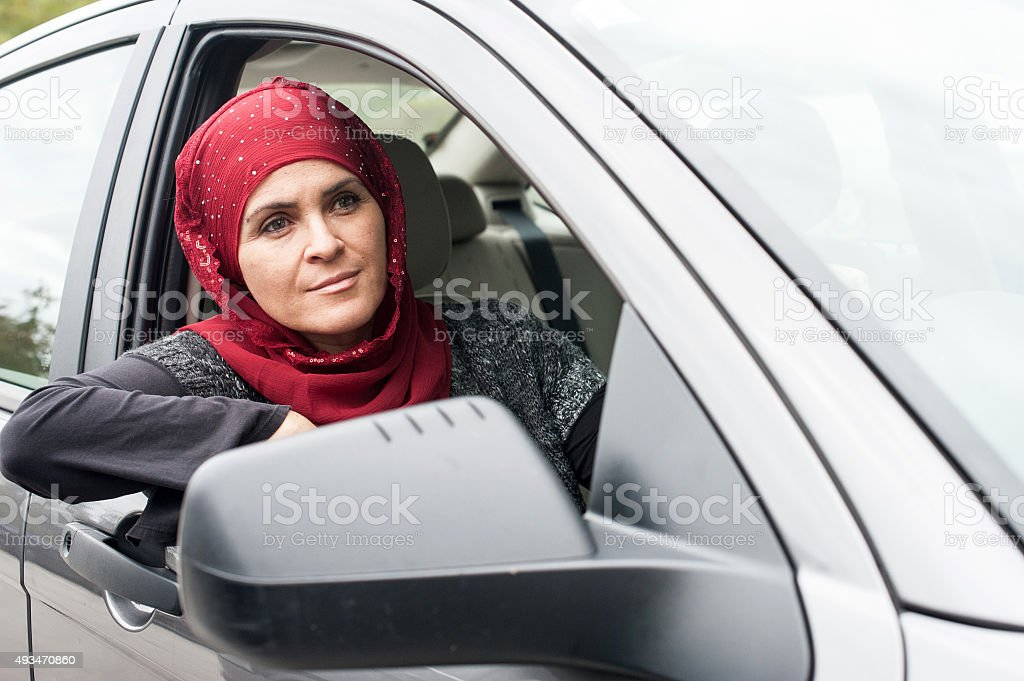 Muslim woman driving stock photo