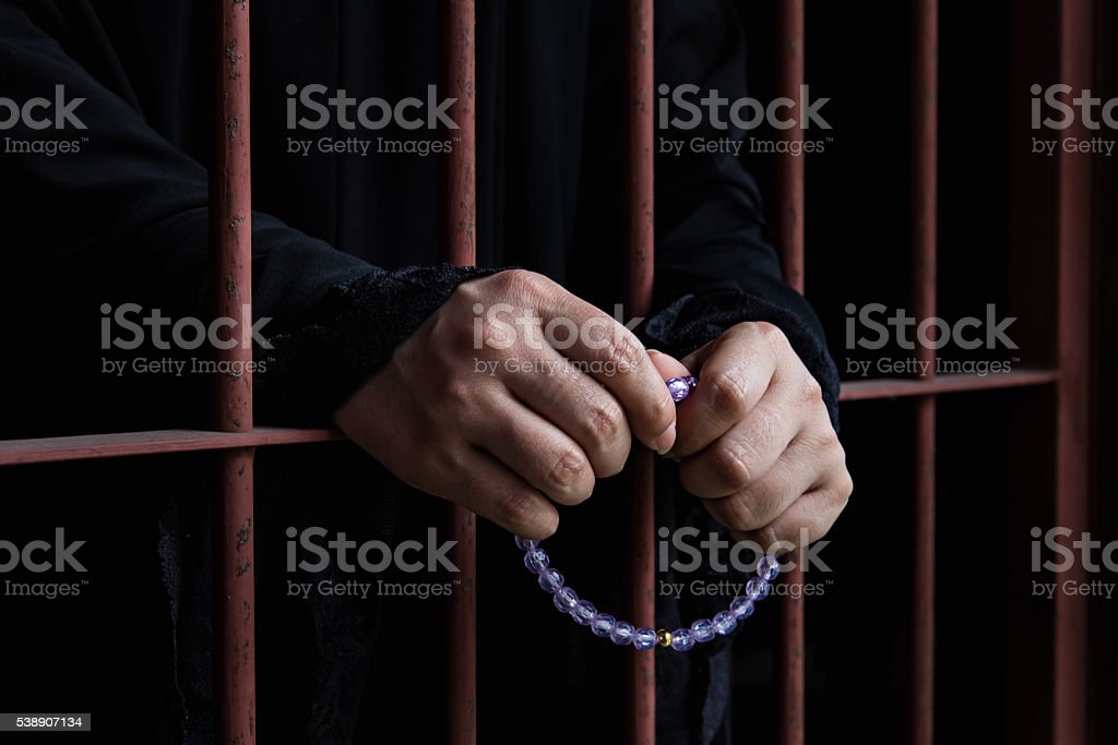 Muslim woman hand in jail stock photo
