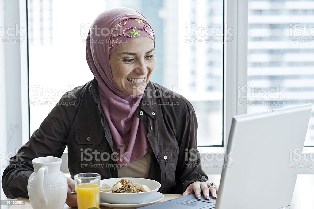 Muslim woman having breakfast royalty-free stock photo