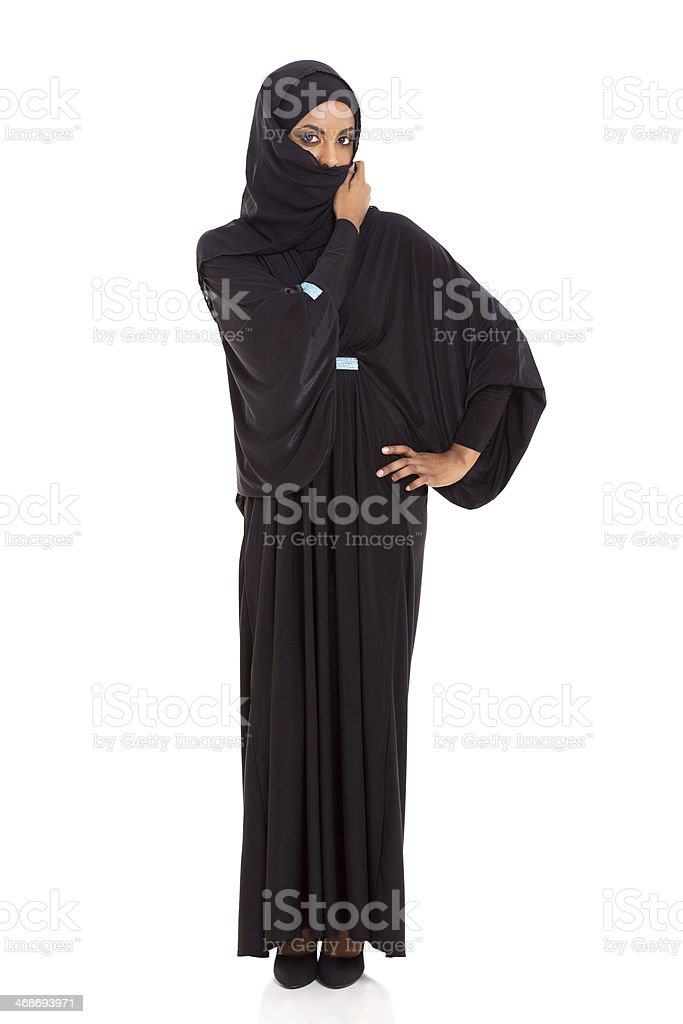 muslim woman hiding her face stock photo