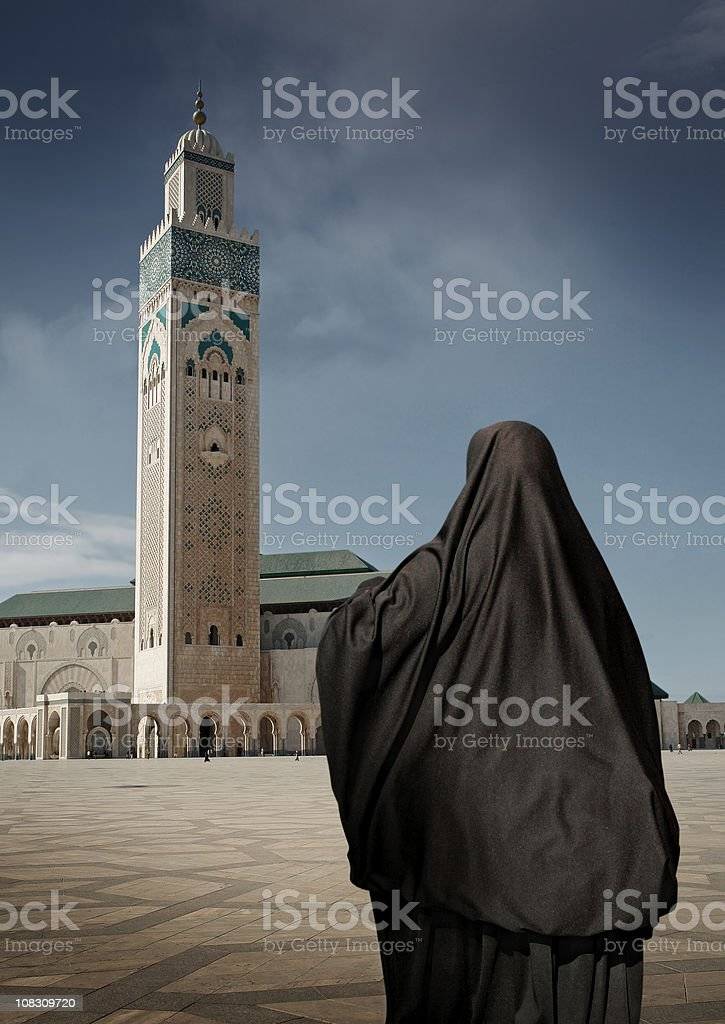 Muslim Woman in Burka at Mosque of Hassan II stock photo