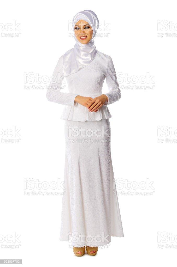 Muslim woman in white dress stock photo