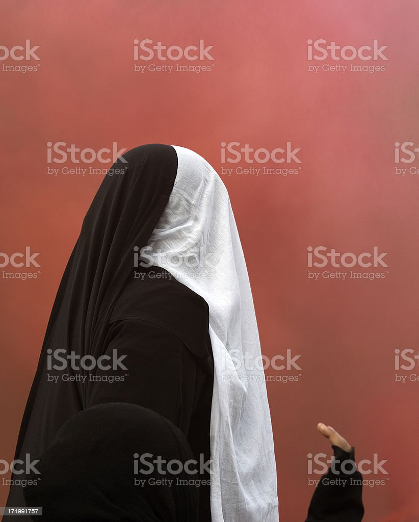 muslim woman isolated on red stock photo