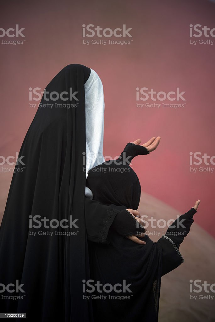 muslim woman isolated on red royalty-free stock photo