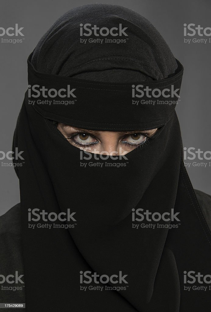 Muslim woman posing wearing a Burkha veil. royalty-free stock photo