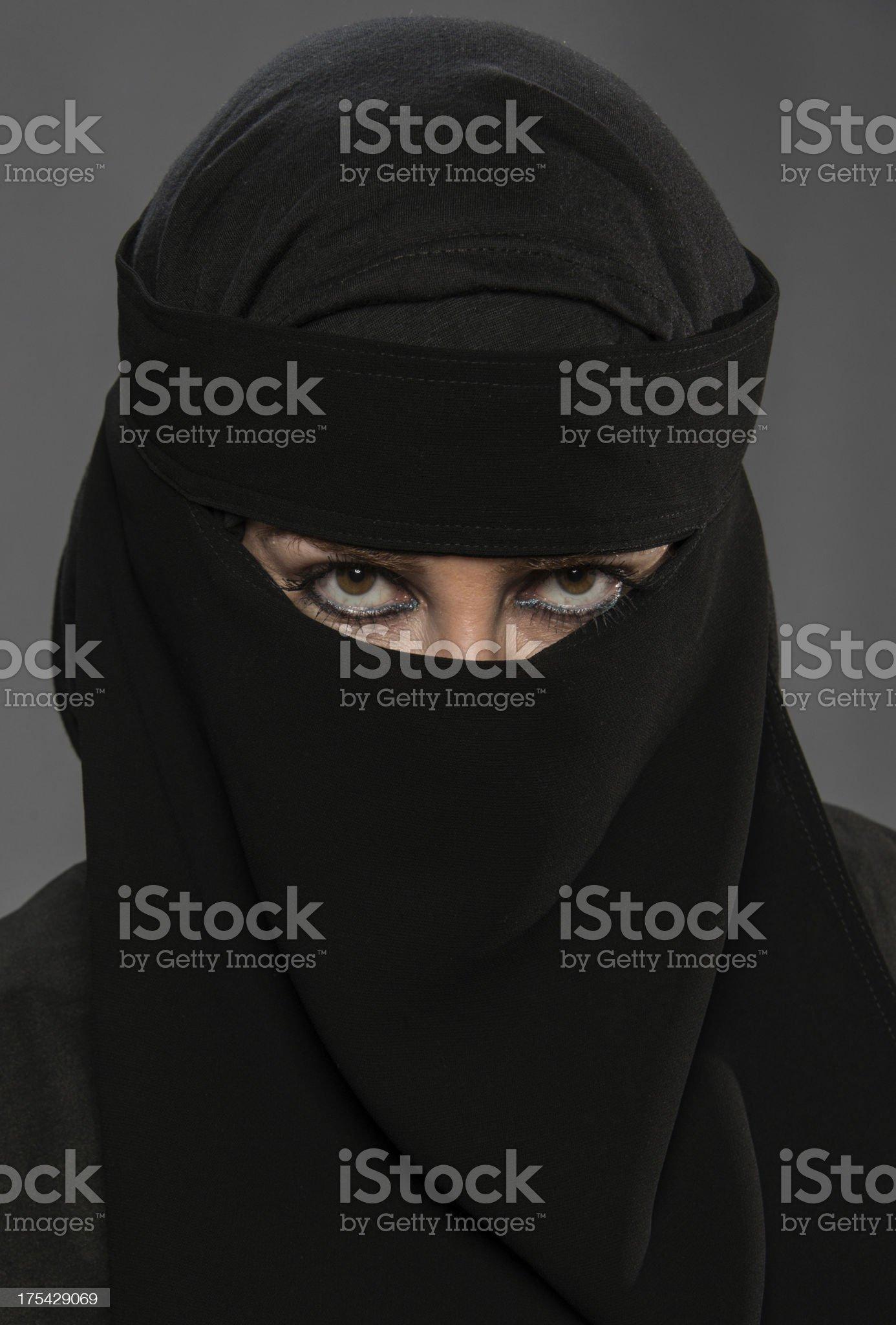 Muslim woman posing wearing a Burkha veil. royalty-free stock photo