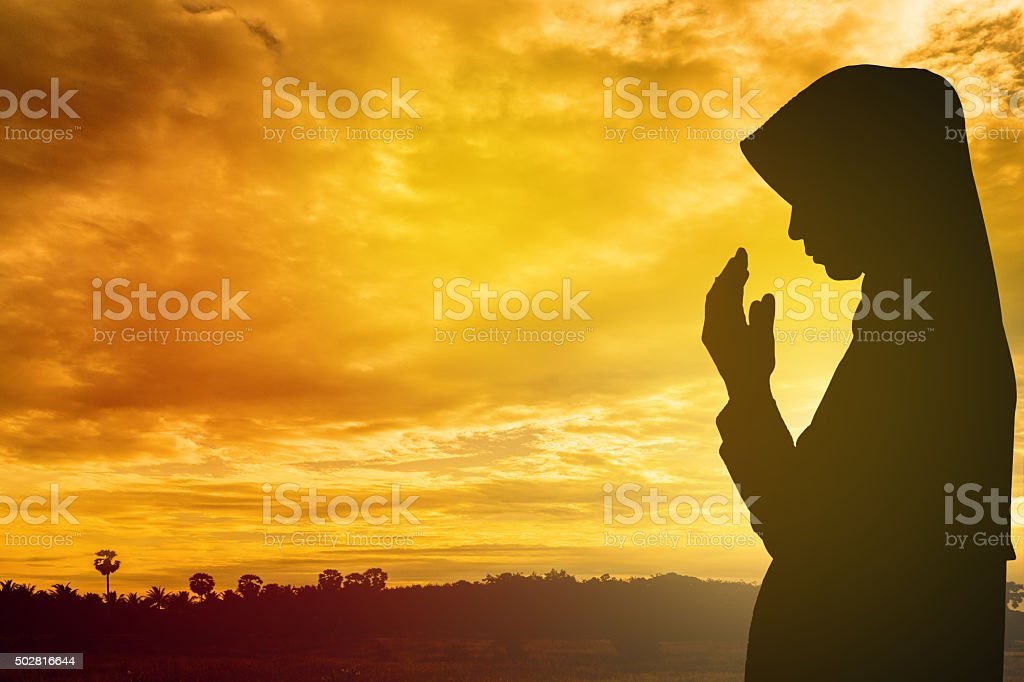 Muslim Woman pray and Beautiful background. pray for ramadan stock photo