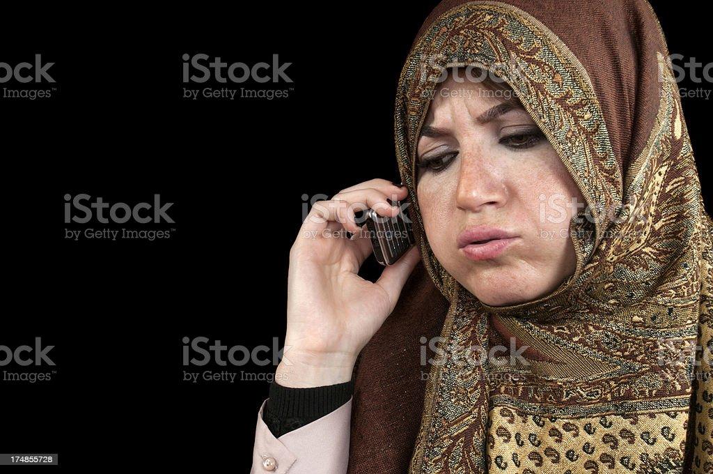 Muslim woman talking on mobile phone royalty-free stock photo