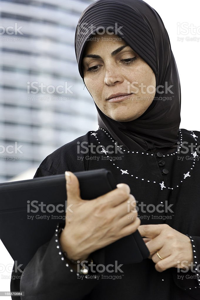 Muslim Woman using an Electronic Tablet royalty-free stock photo