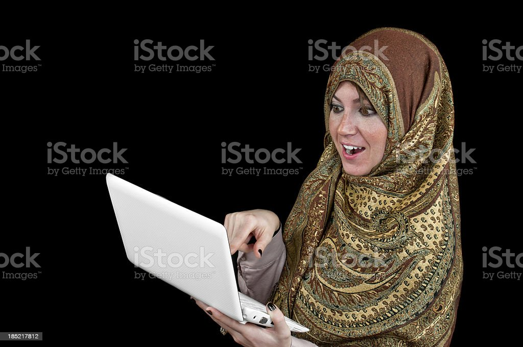 Muslim woman using laptop royalty-free stock photo