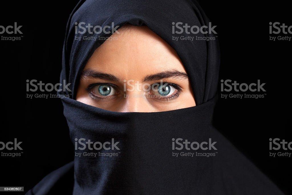 Muslim woman wearing the face veil stock photo