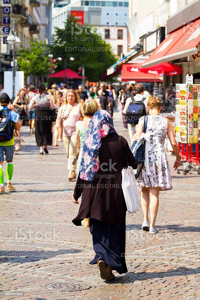 Muslim woman with colored headcarf in Frankfurt Main stock photo