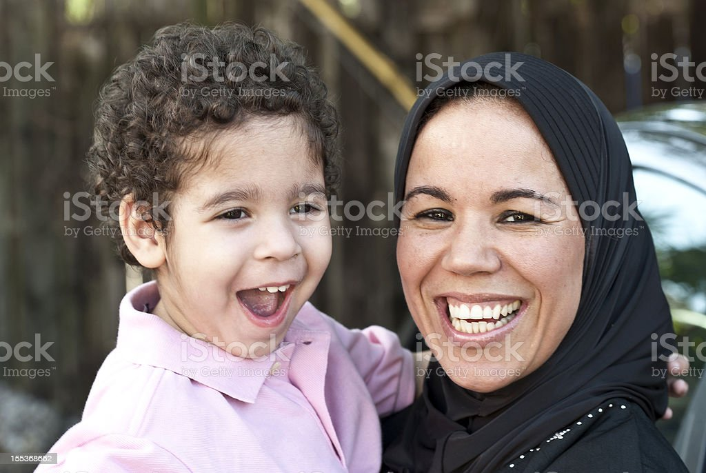 Muslim woman with her son stock photo