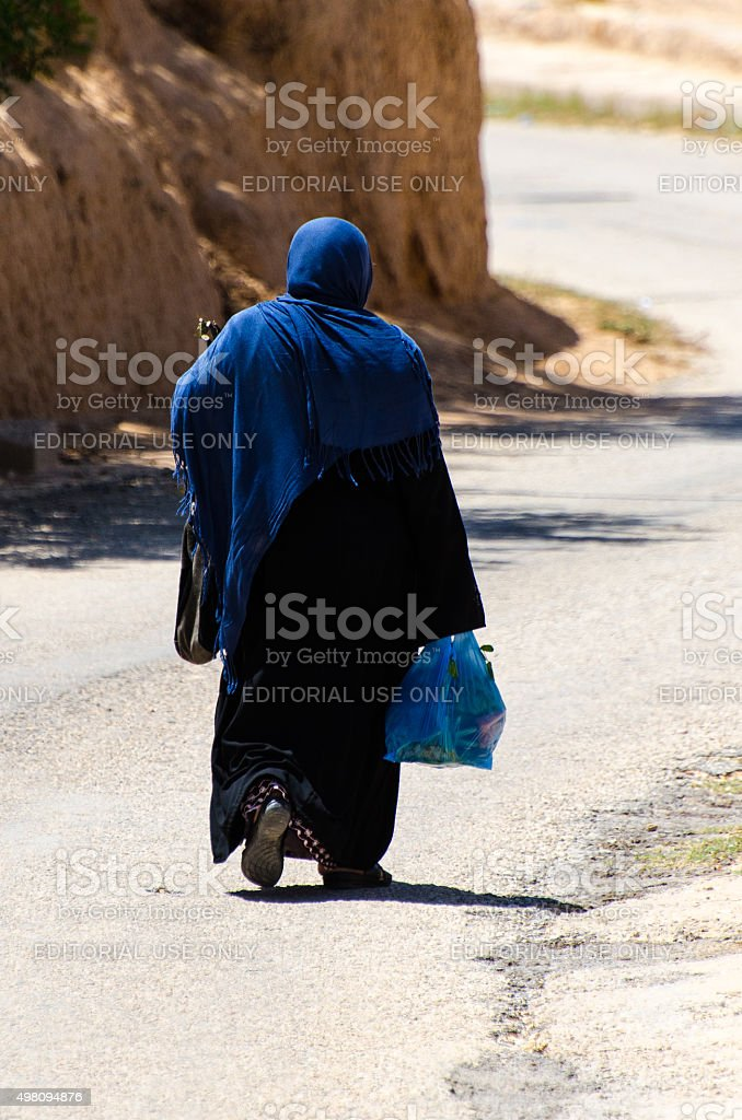 Muslim woman with shopping bag stock photo