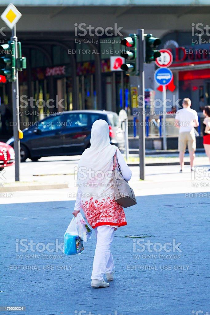Muslim woman with white headcarf stock photo