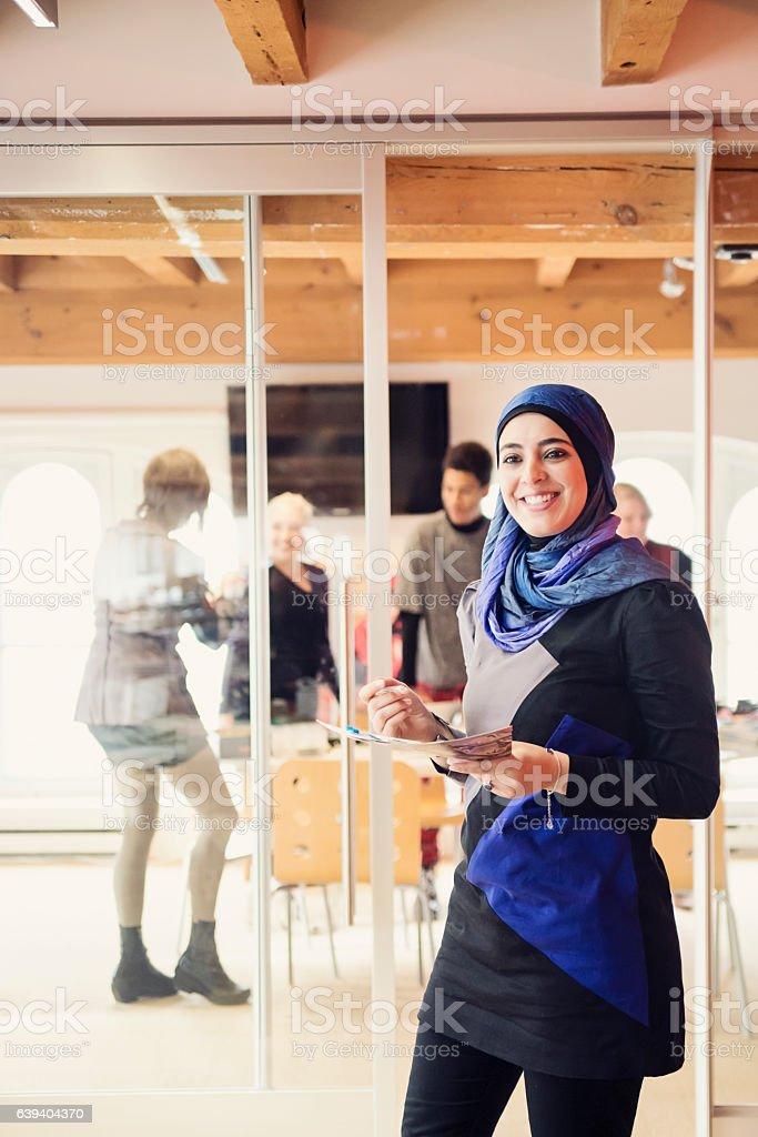 Muslim woman working in small fashion enterprise. stock photo