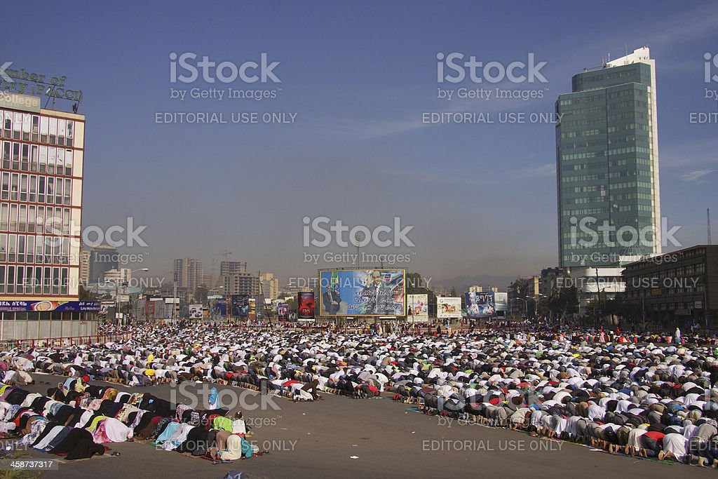 Muslim women and men are praying royalty-free stock photo