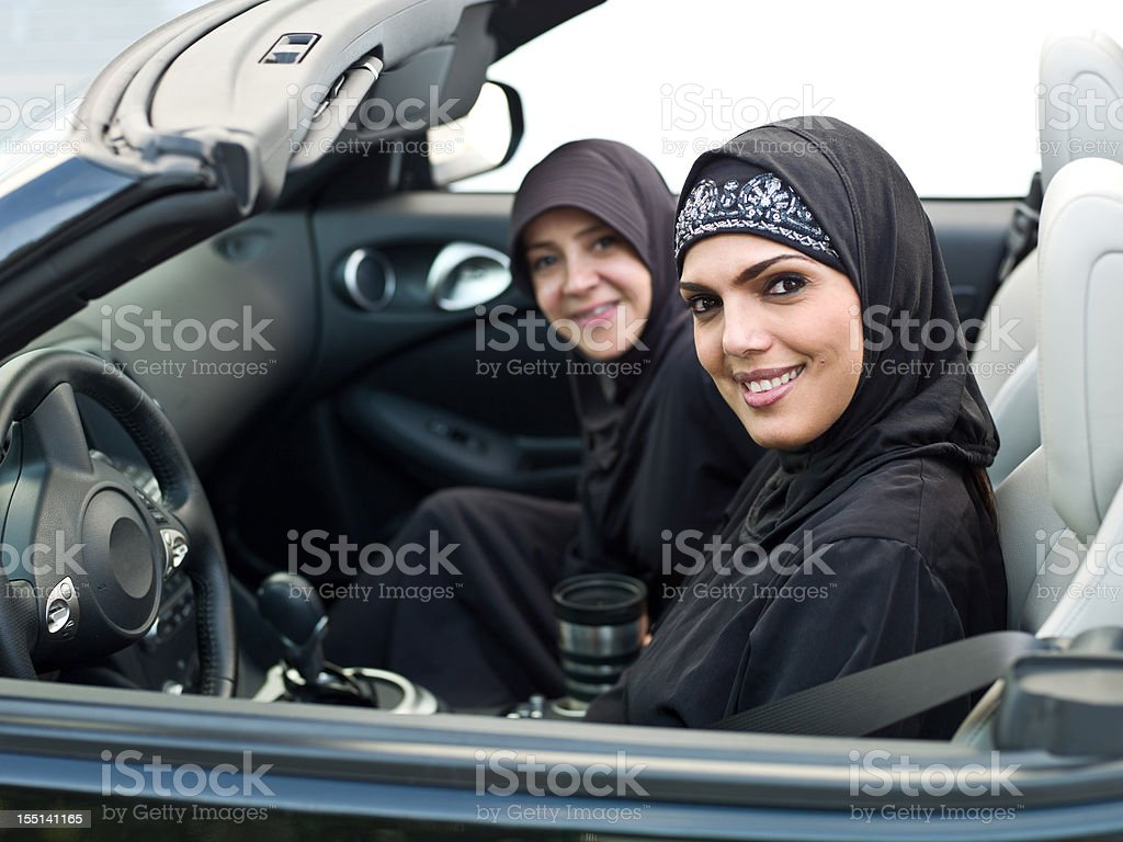 Muslim women in a convertible stock photo