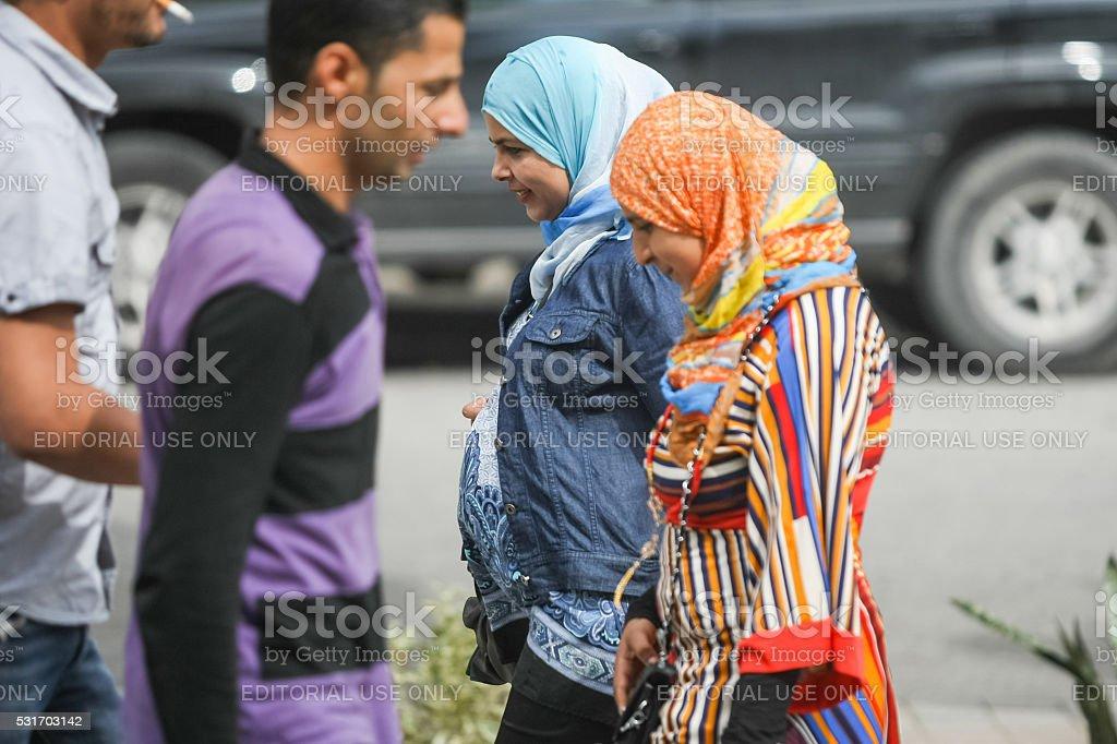 Muslim women in street of Tunis stock photo