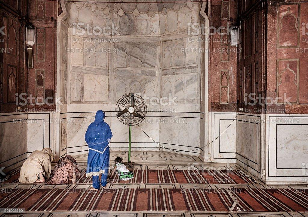 Muslim women praying in Jama Masjid mosque Delhi India stock photo